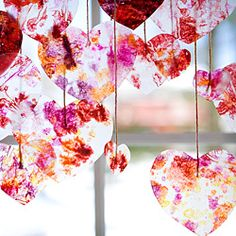 A fun and colorful craft tutorial on how to make beautiful window hearts. Many awesome step-by-step photos and simple directions.