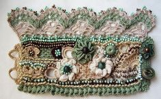 Handmade crochet cuff bracelet made of 100 % cotton thread. There are used different crochet techniques in creating this cuff bracelet – Irish crochet for flowers and several lace crochet patterns.  It is a gentle cuff bracelet in boho style with a little vintage look. The main colors are pea green, coffee brown, ivory and two shades of beige. For decoration I used three types of beads in different colors.  There are three big flowers decorated with semiprecious stone agate in different…