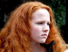 Red hair is the rarest natural hair color in humans.  The genetics of red hair, discovered in 1997, appear to be associated with the melanocortin-1 receptor (MC1R), which is found on chromosome 16. Red hair is associated with fair skin color because of low concentrations of eumelanin throughout the body of those with red hair.