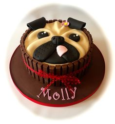 Pug themed birthday cake with kitkats by www.facebook.com/cakeinspirations
