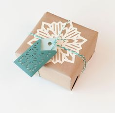Pretty Packages Cricut cartridge -- Snowflake doily gift topper and tag. Make It Now in Cricut Design Space