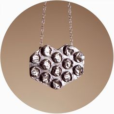 This is one of the coolest things I've seen via Etsy yet! Sterling necklace shaped to look like a bubble wrap heart!