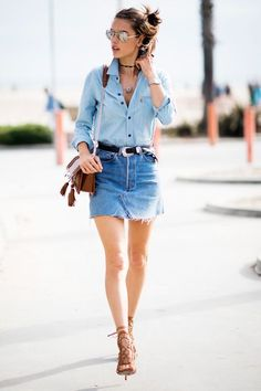 The '90s Miniskirt Off-Duty Models Love #refinery29  http://www.refinery29.com/2016/08/119854/model-off-duty-denim-mini-skirt-outfit#slide-1  Alessandra Ambrosio goes more Western with her denim-on-denim, broken up by a silver-buckled black belt and brown leather accessories. ...