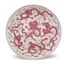 RARE AND LARGE PUCE-ENAMELED 'FIVE DRAGON' DISH, QING DYNASTY, 19TH CENTURY, the interior painted with a front-facing dragon and flaming pearl, surrounded by four further dragons amid flames, the base with a double circle in underglaze blue, D 17 3/4  in.