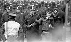 A picket is led away during the Orgreave clash during the Miners Strike 1984.