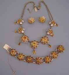 HOBE parure of honey and clear unfoiled rhinestones set in gold tone filigree