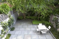 Tidy urban garden. Large scale bluestone pavers; angular plantings. Lush Life: A Townhouse Garden in Manhattan: Remodelista