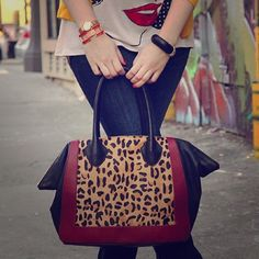 Leopard calf hair winged Handbag Genuine leather winged handbag with leopard print calf hair and marsala/oxblood leather accents. Gold tone zipper closure. Good condition. No trades. Crown Vintage Bags