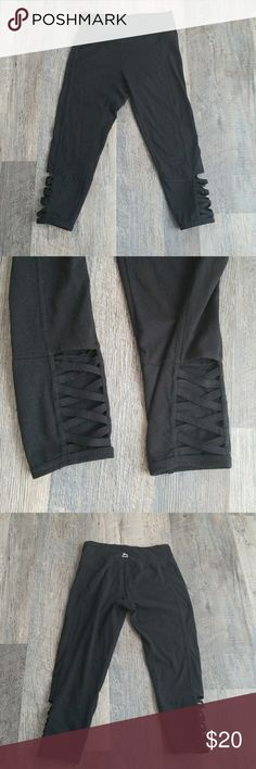 Rbx Black Corset Strap Workout Capris Black athletic capri leggings with criss cross straps on the outer calf. Mid rise and about 3/4 length. Size small. RBX Pants Leggings