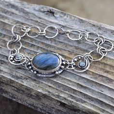 A personal favorite from my Etsy shop https://www.etsy.com/listing/266841127/sterling-silver-and-labradorite-bracelet