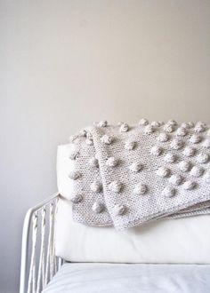 "Falling Bobbles Blanket      9skeins Purl Soho's Lanecardate Feltro (75% superfine wool, 25% Caregora angora)      size 15 needles     gauge: 10 st &13 rows = 4"" (10cm) in stockinette stitch     finished size: 34"" w x 47"" l"