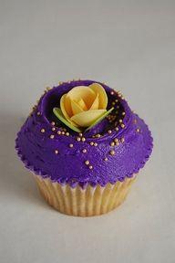 Beautiful royal purple cupcake with rose