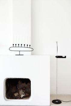 Nordic-Bliss-Scandinavian-style-minimalistic-white-Danish-design-home-interior-fire-place