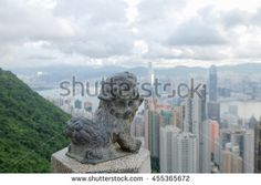 THE VICTORIA PEAK , HONG KONG - JULY 1 : The lion statue at the Victoria Peak…