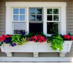 How to make your own window box. You wouldn't believe the difference a window box makes. They give your home character and beauty.