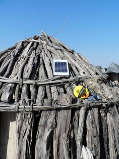 Solar charging on a traditional Himba hut in Namibia's Kunene Region.