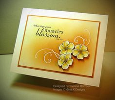Pretty card - note the sponging background, heat embossed swirls, colored blossoms cut & mounted, then colored card stock base