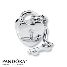 From the PANDORA Moments Spring 2012 collection, this sterling silver charm depicts a heart lock with a dangling key. Style # 790971.