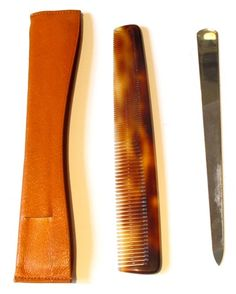 Hermès leather case holding comb & nail file- part of 1950's Black Leather Toiletry Case