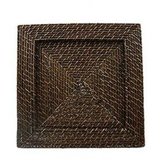 """Anchor your dining table centerpiece or entryway vignette with this brown rattan charger plate, showcasing an organic-inspired woven design.    Product: Set of 4 charger platesConstruction Material: RattanColor: BrownDimensions: 13"""" W x 13"""" DNote: For decorative use only"""