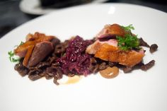 Medium rare duck breast at Sepia resting on red cabbage. Perfectly cook, just the right amount of everything!