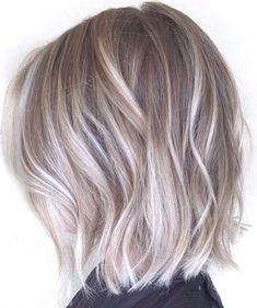 medium choppy cut ash blonde and silver ombre