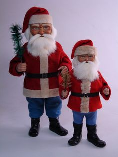 Two paper mache *German Santas* candy container by Paul Turner studio