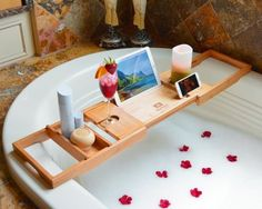 """A bathtub tray that takes """"working from home"""" to a whole new level.   30 Things That'll Make Bath Time Even Better"""