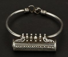 Gujarat, Northwest India | Silver bracelet with a Ta'vis (amulet container) from the beginning of the 20th century. | 550€