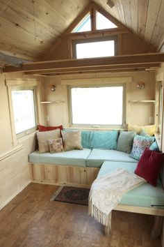 """The SimBLISSity 26' Judy Blue Eyes is one of the latest """"Aspen"""" design Tiny Homes on Wheels built by SimBLISSity Tiny Homes in Lyons, Colorado. This custom Tiny was built for a delightful, colorful…"""