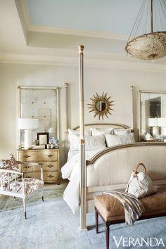 Custom bed, David Sutherland Showroom; monogrammed pillows, Leontine Linens; sunburst mirror, Tara Shaw Antiques; pendant, Fortuny through Lovelace Interiors.   - Veranda.com