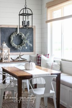 Prepare your space for winter weather with inspiration from this farmhouse-style home tour. Plaid throw pillows and natural decor give this room a rustic feel.