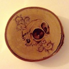$120 - Cat skull and acanthus scroll wood burning on birch round with bark
