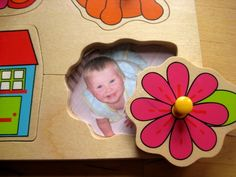 personalized baby jigsaw puzzle. SO cute! Cut pictures of people in the baby's life and glue them to the board. When the baby removes a piece,- PEEK_A_BO!
