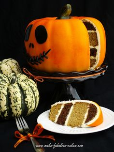 Pumpkin Cake Tastefully Simplified - Make Classy Chocolate Pound Cake and Absolutely Almond Pound Cake according to directions.  Layer them and frost.  Cover in orange colored frosting (Can frost entire cake in Duncan Hines Pumpkin Spice Frosting Creations) and decorate with Gel pens.