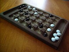Yoté is a traditional strategy board game of West Africa