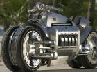 """The Dodge Tomahawk looks more like a motorcycle than a car and calling it a car is a stretch. But, with four wheels and the same V-10 engine used in the Dodge Viper sports car, calling it a motorcycle isn't accurate either. A press release from the Chrysler Group referred to it as a """"rolling sculpture,"""" a description that will have to do."""