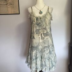 Staring At Stars Flowey Dress- Sm Lonely Ivory lining with a sheer grey & Ivory patterned overlay- soft ruffled hemline . Bodice has a cute 6 button closure with ruffled trim. Adjustable spaghetti straps. Excellent condition  Urban Outfitters Dresses
