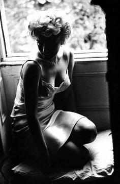 Marilyn Monroe | satin slip | silk | lingerie | kneel | window seat | light and shade | stunning | black  white photography | vintage | hollywood starlet | iconic actress | beauty