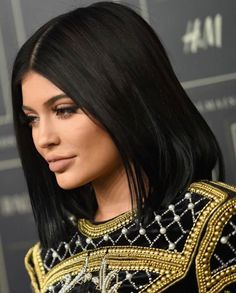 At the Balmain and H&M fashion show in New York City on October 20, 2015, the reality star looked stunning in one of the designer's black and heavily gold-embroidered mini-dress and matching thigh high black boots....