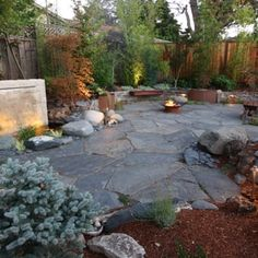 slate patio with water feature and firepit - Yelp