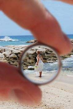"""Why We Love It: Capture a photo of the bride through the groom's wedding ring!Why You Love It: """"I think it is such a great idea, so super cute, like seeing through the groom's eyes."""" —Julia O. """"Circle of love... eternal. Love it"""" —Maggie S. """"I used to be an art major, and I always love things slightly more original — which this is. It plays great with line texture and color. The photo has great movement, not to mention the symbology."""" —Manda B. """"It's beautiful, symbolic, and unique. Love…"""