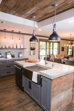 The kitchen in the newly renovated Ridley home features a double island, a custom raised ceiling above the islands, stainless steel appliances, and a custom concrete countertop, as seen on Fixer Upper. (after) #HomeAppliancesChecklist