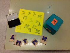 playing with stamps: make stamps of the Hebrew letters, each child at time strip die and have to seal the letter that  play him