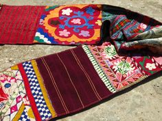 ETHNIC TREE: Ethnic scarf whose base is made from a patchwork of vintage fabric coming from a variety of cultures, including Vietnam, Indonesia, Afghanistan, Jordan, India (Gujurat and Rajasthan), Palestine. The textiles come from a variety of sources including old tableclothes, blouses, suzanis, dresses, hiupils, etc. The scarf is entirely handmade and is a unique piece. www.ethnictree.com