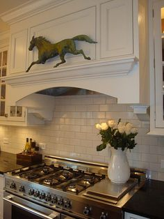 Subway tile with stainless stove and hood