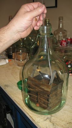 adding a roof to a cabin in a bottle.
