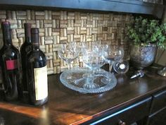 Behind the baker's rack (where wine decanter sits) ... Wine Cork Backsplash - 22 Creative and Useful DIY Ideas with Wine Cork