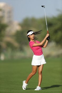 649945a3b6e398 Muni He Photos - Muni He of China plays her second shot on the 13th hole.  Golf With FriendsSexy ...