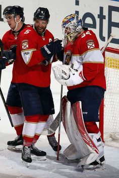SUNRISE, FL - FEBRUARY 3: Goaltender James Reimer #34 of the Florida Panthers and teammate Aaron Ekblad #5 celebrate their 2-1 win over the Anaheim Ducks at the BB&T Center on February 3, 2017 in Sunrise, Florida. (Photo by Eliot J. Schechter/NHLI via Getty Images)